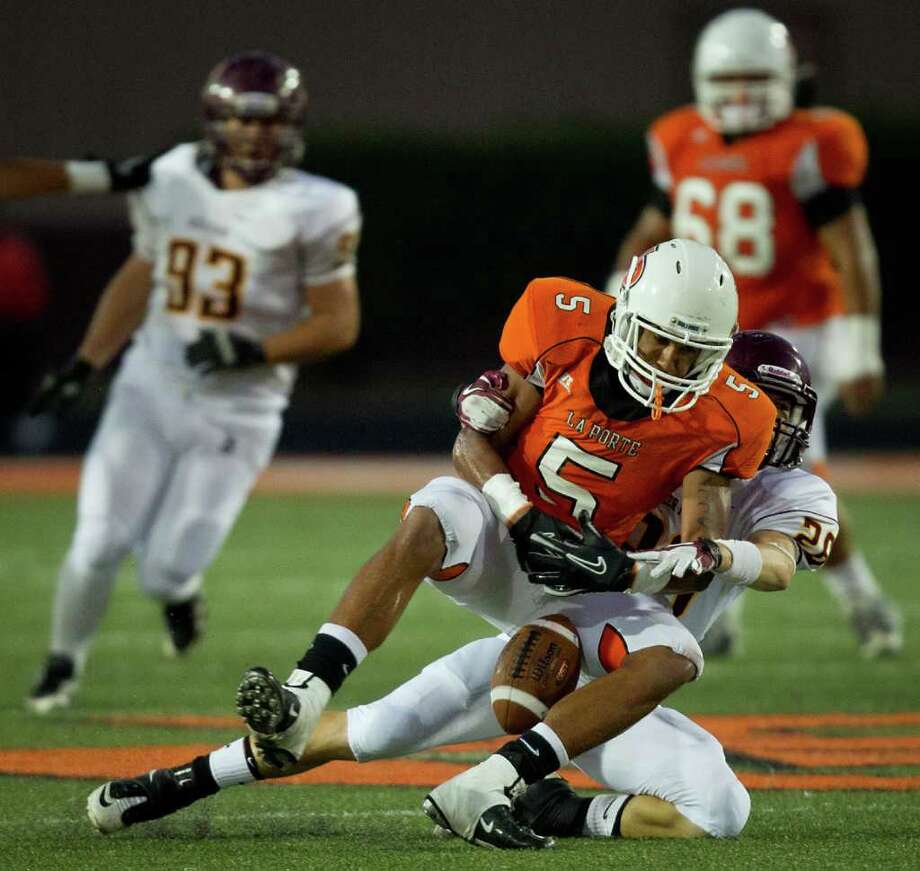 La Porte receiver Aaron Nance-Garrett (5) can't hold onto a pass as he is hit by Deer Park defensive back Anthony Gutierrez (20). Photo: Smiley N. Pool, Houston Chronicle / © 2011  Houston Chronicle