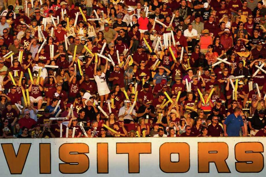 Deep Park fans cheer their team from the visitors side of the stadium before facing rival La Porte. Photo: Smiley N. Pool, Houston Chronicle / © 2011  Houston Chronicle