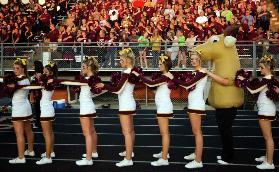 The Deer Park mascot joins the team's cheerleaders for the nation anthem. Photo: Smiley N. Pool, Houston Chronicle / © 2011  Houston Chronicle