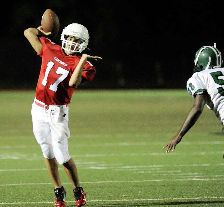 Greenwich High School quarterback Jose Melo, # 17, in action during football game between Bassick High School of Bridgeport and Greenwich High School at Greenwich, Friday night, Sept. 23, 2011.  There is no # 58 on the Bassick roster. Photo: Bob Luckey / Greenwich Time