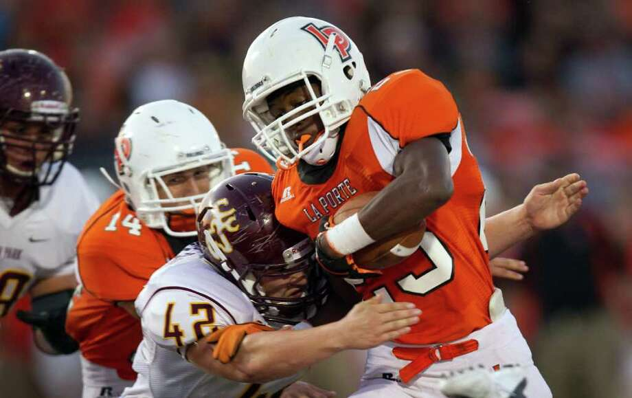 La Porte running back Jonathan Lewis (23) is hit by Deer Park linebacker  Casey Westmoreland (42) during the first quarter. Photo: Smiley N. Pool, Houston Chronicle / © 2011  Houston Chronicle