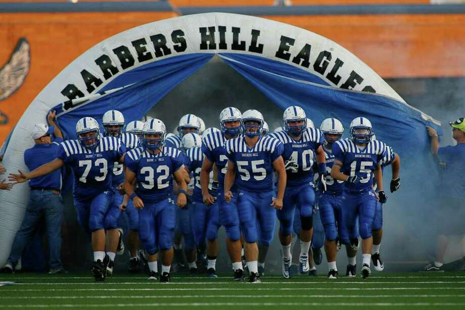 Barbers Hill Eagals run onto the field as they host Dayton Friday evening September 23, 2011 at Eagle Stadium in Mont Belvieu for the first night of District 19-4A play. Barbers Hill is undefeated  and Dayton is 2-1 going into the game.