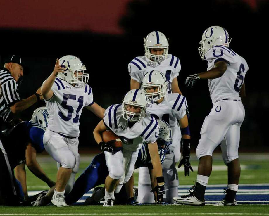 Dayton senior Logan Sullivan (2) comes up with a Barbers Hill fumble Friday evening September 23, 2011 at Eagle Stadium in Mont Belvieu during the first night of District 19-4A play. Barbers Hill is undefeated  and Dayton is 2-1 going into the game. The Eagles lead 17-14 at the half.  Nathan Lindstrom/For the Chronicle  ©2010 Nathan Lindstrom Photo: Nathan Lindstrom, Freelance / ©2011 Nathan Lindstrom