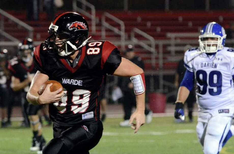 Fairfield Warde's Kevin Krug (89) runs for yardage during the football game against Darien at Fairfield Warde High School on Friday, Sept. 23, 2011. Photo: Amy Mortensen / Connecticut Post Freelance