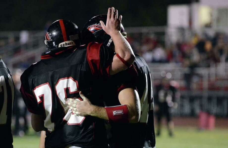 Fairfield Warde's John McKeown (76) congratulates teammate Joe Marx (44) on a touchdown during the football game against Darien at Fairfield Warde High School on Friday, Sept. 23, 2011. Photo: Amy Mortensen / Connecticut Post Freelance