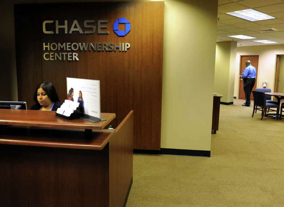 Johanna Loyola works in the new Chase Homeownership Center, a walk in center for distressed borrowers to meet with loan officers to discuss options, at 99 Hawley Lane in Stratford, Conn.  This is the first Chase center of its kind to open in the state. Photo: Autumn Driscoll