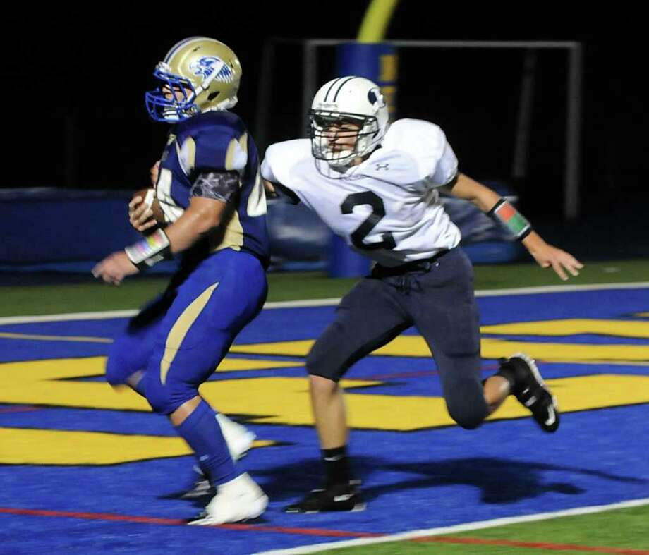 Newtown's Louis Fenaroli makes a touch down while Immaculate's Shane Raymond tries to stop him during an Immaculate High school vs Newtown High School football game at Newtown on Friday Sept. 23,2011. Photo: Lisa Weir / The News-Times Freelance