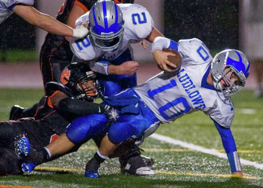 Ridgefield High School's Adrian Jones takes down Fairfield Ludlowe's Tommy Howell as he tries to get an extra yard during a football game at Ridgefield. Friday, Sept. 23, 2011 Photo: Scott Mullin / The News-Times Freelance