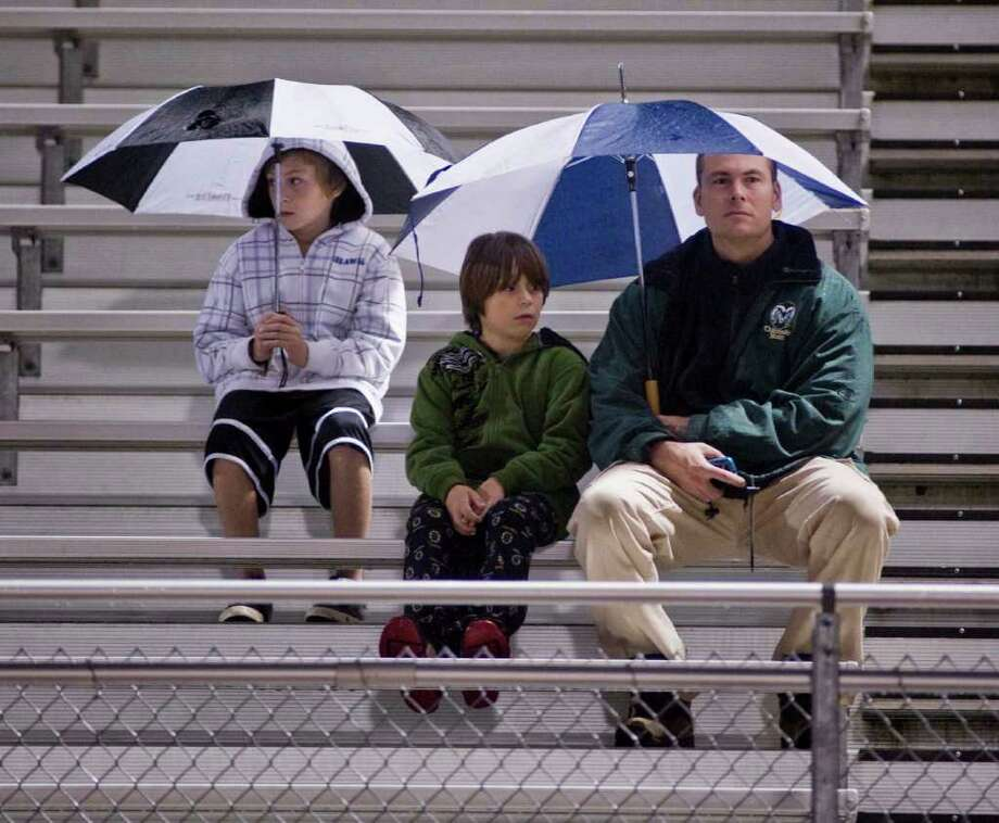 Fans braving the rain during the Ridgefield High School and Fairfield Ludlowe football game at Ridgefield. Friday, Sept. 23, 2011 Photo: Scott Mullin / The News-Times Freelance