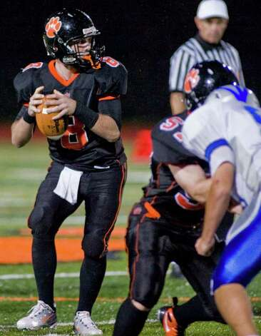 Ridgefield High School's Connor Rowe looks for a receiver in a football game against Fairfield Ludlowe at Ridgefield. Friday, Sept. 23, 2011 Photo: Scott Mullin