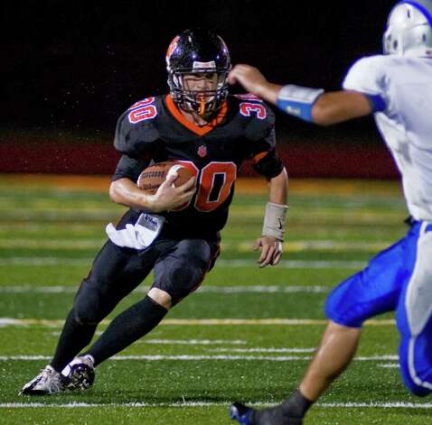 Ridgefield High School's Sam Gravitte carries the football in a game against Fairfield Ludlowe at Ridgefield. Friday, Sept. 23, 2011 Photo: Scott Mullin