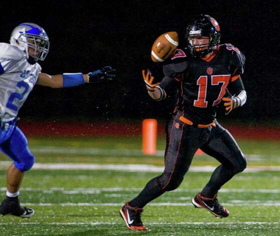 Ridgefield High School's Matthew Flanagan tries to find the handle during a football game against Fairfield Ludlowe at Ridgefield. Friday, Sept. 23, 2011 Photo: Scott Mullin