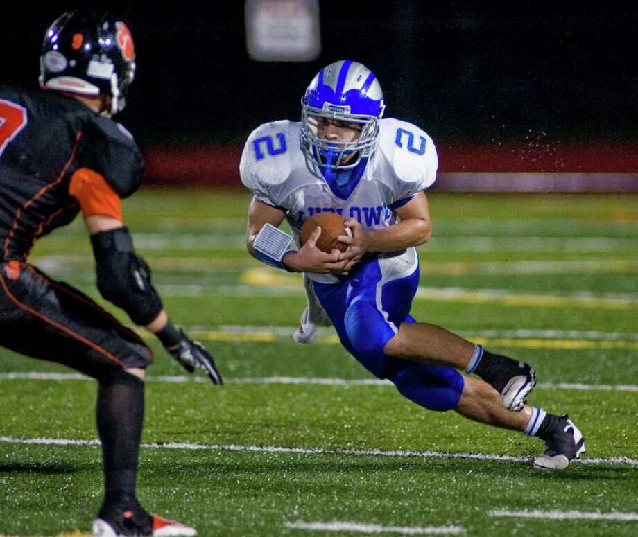 Fairfield Ludlowe's Patrick Ferrio carries the football during a game against Ridgefield High School, at Ridgefield. Friday, Sept. 23, 2011 Photo: Scott Mullin / The News-Times Freelance