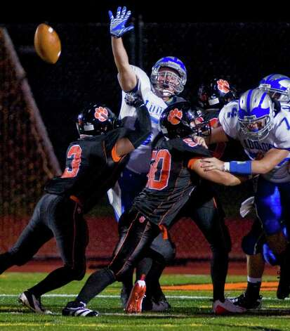 Fairfield Ludlowe's Jake Garrell tries to block an extra point kick by Ridgefield High School during a football game at Ridgefield. Friday, Sept. 23, 2011 Photo: Scott Mullin / The News-Times Freelance