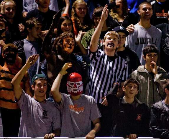 Ridgefield High School fans cheering the team during a football game against Fairfield Ludlowe at Ridgefield. Friday, Sept. 23, 2011 Photo: Scott Mullin / The News-Times Freelance