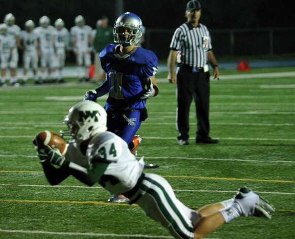 Highlights from boys football action between Bunnell and New Milford in Stratford, Conn. on Friday September 23, 2011. A pass intended for Bunnell's #11 Jared Vasquez, in back, is intercepted by New Milford's #34 Tevan Leonard. Photo: Christian Abraham / Connecticut Post