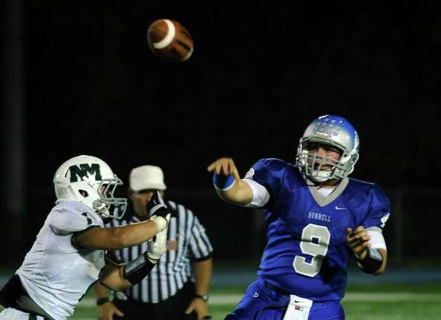 Highlights from boys football action between Bunnell and New Milford in Stratford, Conn. on Friday September 23, 2011. Bunnell QB #9 Bryan Castelot. Photo: Christian Abraham / Connecticut Post