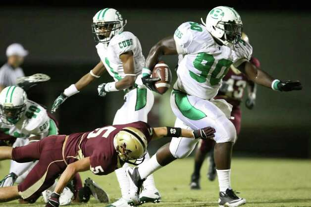 Brenham's Malcom Brown (90) scampers past Magnolia West's Jeremy Jordan for a 50-yard touchdown reception in the first quarter of their game, Friday at Mustang Stadium in Magnolia. Photo: Eric Christian Smith, For The Chronicle