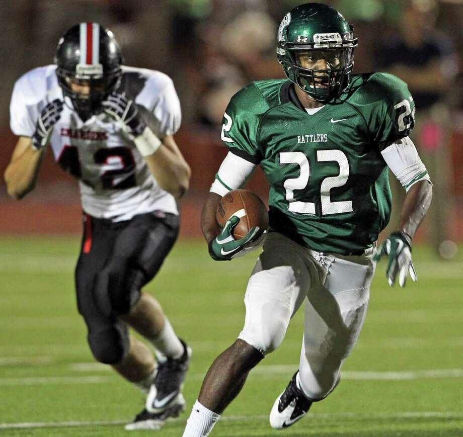 Rattler running back Elijah Ball clears out in the first half as Reagan plays Churchill at Heroes Stadium  on September 23, 2011.  Tom Reel/Staff Photo: TOM REEL, Express-News / © 2011 San Antonio Express-News