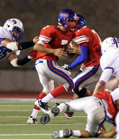 Jefferson quarterback Jorge Flores struggles to make a play as he is tackled by Lanier's Fernando Delarosa in the first half of the Lanier vs. Jefferson matchup at Alamo Stadium, Friday, September 23, 2011. Photo: Jennifer Whitney, Express-News / special to the Express-News