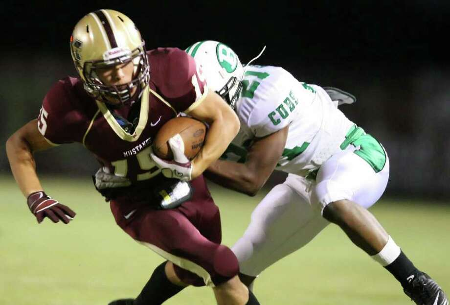 Magnolia West's Brady Bynum (15) is tackled by Brenham's Robert Felder during the first half of their game, Friday at Mustang Stadium in Magnolia. Photo: Eric Christian Smith, For The Chronicle