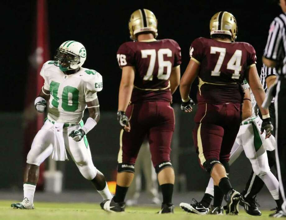 Brenham's Jerid Jeter-Gilman (40) celebrates a tackle during the first quarter of the Cubs' game against the Magnolia West Mustangs, Friday at Mustang Stadium in Magnolia. Photo: Eric Christian Smith, For The Chronicle