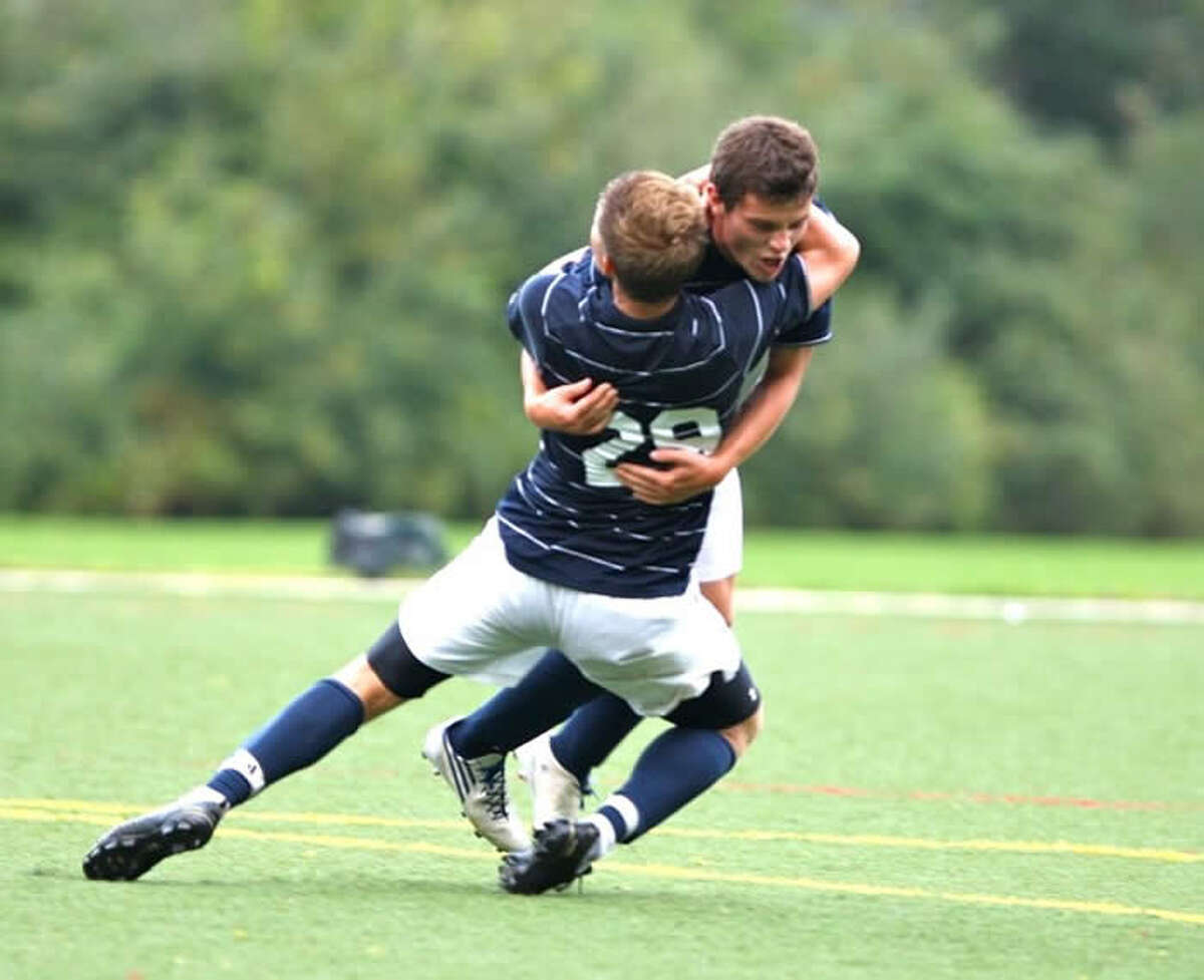 Staples' Steven Smith, 29, hugs Terrance Gibbons Thursday after Gibbons' goal in a 1-0 victory at Wilton.
