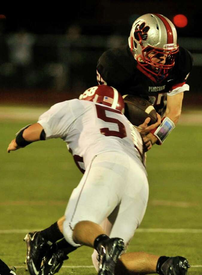 Bethel's Tyler Gall puts the hit on Pomperaug's Dylan McAllister during their game at Pomperaug High School in Southbury on Friday, Sept. 23, 2011. Photo: Jason Rearick / The News-Times