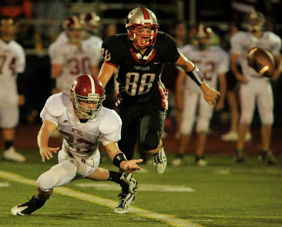Bethel's Matthew Kessler, left, competes with Pomperaug's Brett Gaughan for the pass intended for Kessler during their game at Pomperaug High School in Southbury on Friday, Sept. 23, 2011. Photo: Jason Rearick / The News-Times
