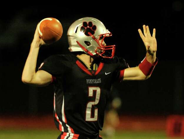 Pomperaug quarterback Eric Beatty readies to throw during their game against Bethel at Pomperaug High School in Southbury on Friday, Sept. 23, 2011. Photo: Jason Rearick / The News-Times