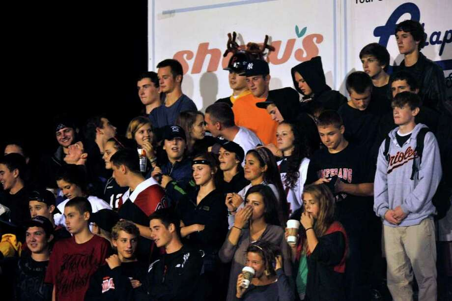 Pomperaug fans during their game against Bethel at Pomperaug High School in Southbury on Friday, Sept. 23, 2011. Photo: Jason Rearick / The News-Times