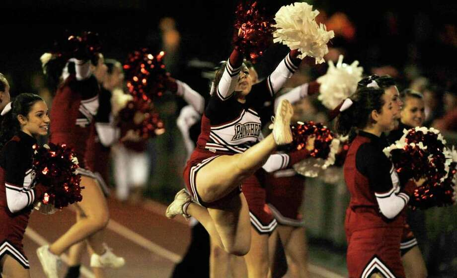 Pomperaug cheerleaders pump up the fans during their game against Bethel at Pomperaug High School in Southbury on Friday, Sept. 23, 2011. Photo: Jason Rearick / The News-Times