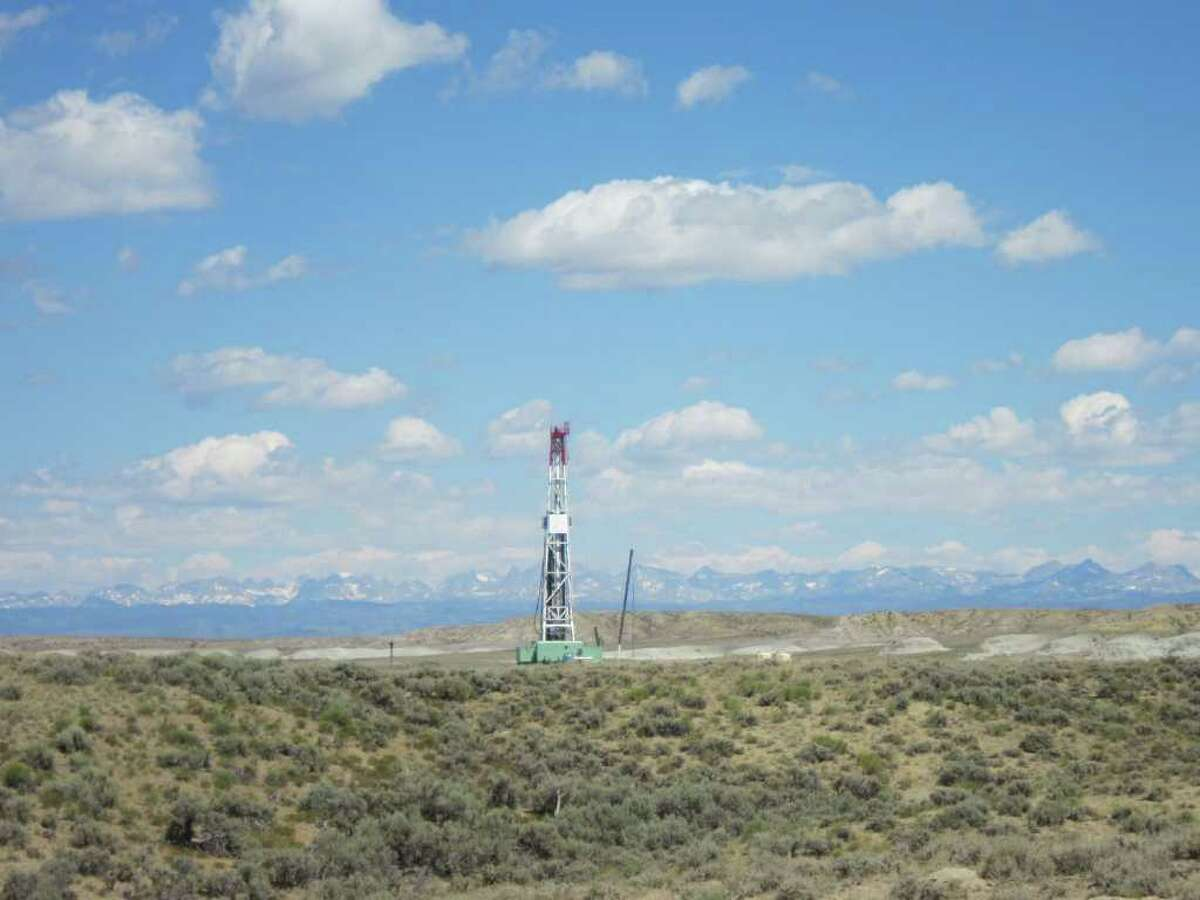 Drilling rigs dot the Pinedale Anticline Project, where companies are trying to mitigate the environmental impact of oil and gas development.