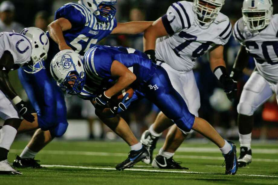 NATHAN LINDSTROM: FOR THE CHRONICLE HEADING IN THE RIGHT DIRECTION: Barbers Hill fullback Clay McDonald, center, leans forward for some extra yardage during Friday night's victory over Dayton. Photo: Nathan Lindstrom / ©2011 Nathan Lindstrom