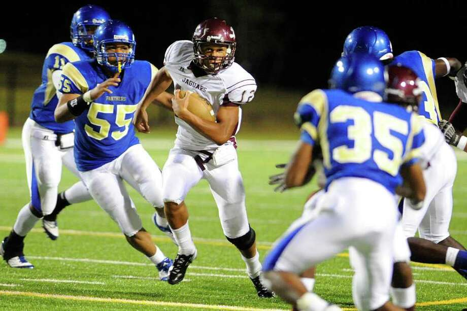 Jaguars quarterback Robert Mitchell, center, finds a hole to run through against the Ozen Panthers in the first half of their crosstown rivalry game on Friday at the BISD Thomas Center. September 23, 2011.  Valentino Mauricio/The Enterprise