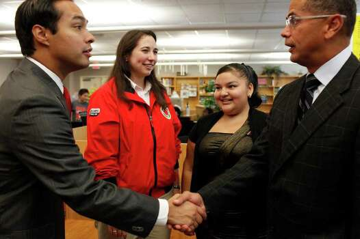Mayor Julian Castro, left, shakes hands with SAISD Superintendent Robert Duron while Abby Hildebrand, left, Team Leader for City Year at Twain Middle School, and Eighth grader Ashlee Sepulveda, 13, right, look on after Castro held a press conference announcing the Wake Up! Initiative for San Antonio at Mark Twain Middle School in San Antonio on Friday, Sept. 23. 2011. Photo: LISA KRANTZ, LISA KRANTZ/lkrantz@express-news.net / SAN ANTONIO EXPRESS-NEWS