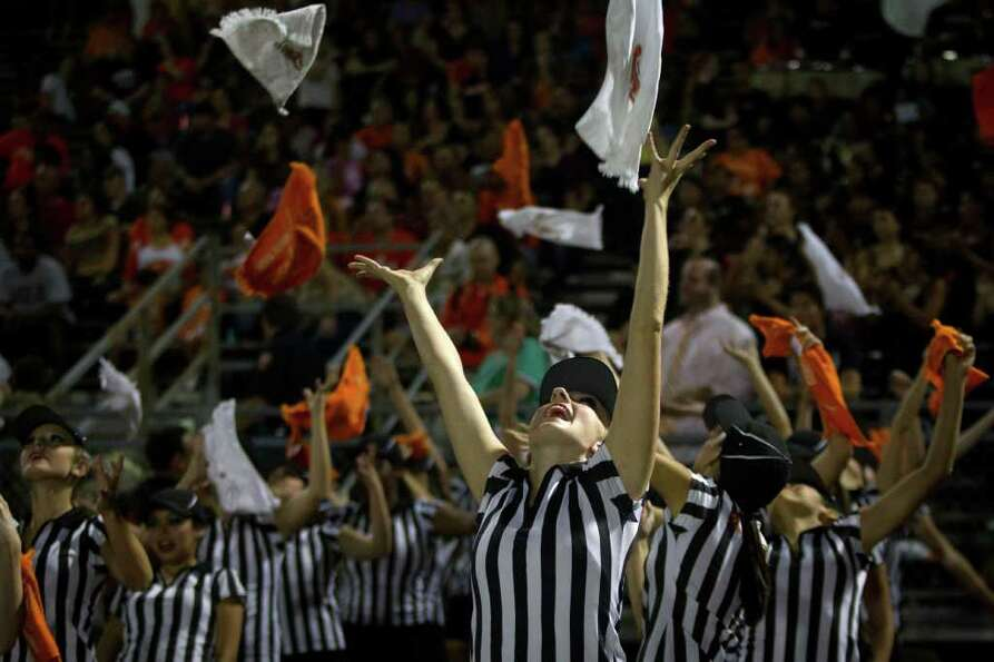 La Porte drill team members toss towels in the air as they perform on the sidelines during the secon