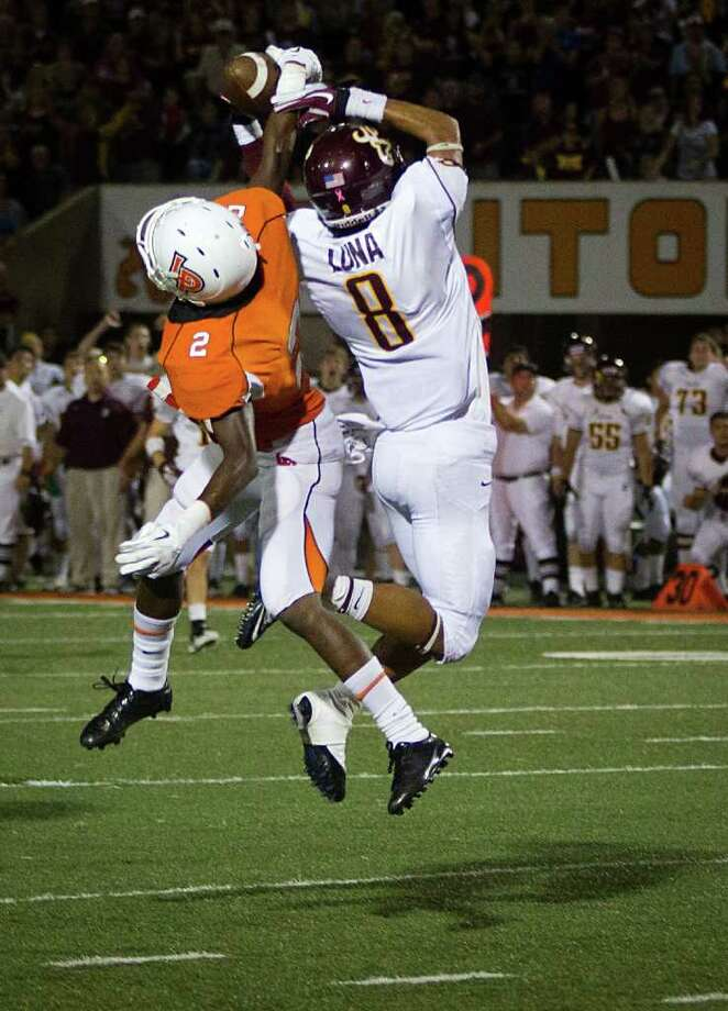 La Porte defensive back Ellis Hutchinson (2) breaks up a pass intended for Deer Park receiver Eric Luna (8) during the second half. Photo: Smiley N. Pool, Houston Chronicle / © 2011  Houston Chronicle