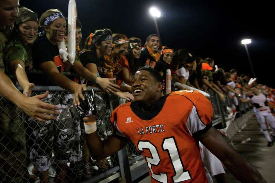 La Porte running back Keith Whitely (21) celebrates with the crowd after his touchdown in overtime gave the Bulldogs the victory over rival Deer Park  in a high school football game at  Bulldog Stadium, Friday, Sept. 23, 2011, in La Porte. Photo: Smiley N. Pool, Houston Chronicle / © 2011  Houston Chronicle