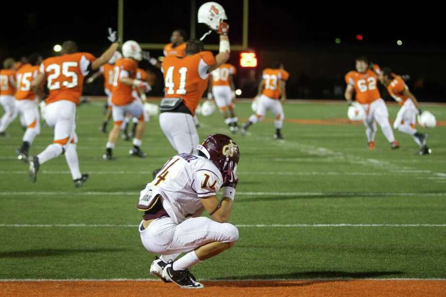 Deer Park defensive back Ryan Martinez reacts as La Porte players run onto the field in celebration after scoring a touchdown in overtime for the victory. Photo: Smiley N. Pool, Houston Chronicle / © 2011  Houston Chronicle