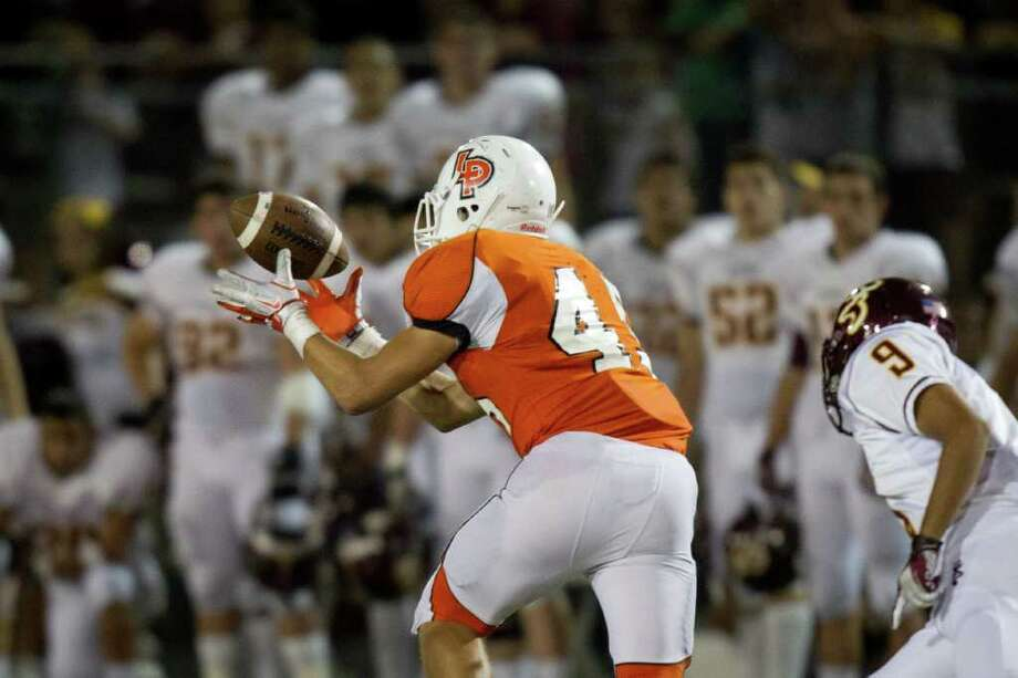 La Porte linebacker Cameron Whilley (45) intercepts a pass intended for Deer Park receiver Suchit Amin (9) during the second half. Photo: Smiley N. Pool, Houston Chronicle / © 2011  Houston Chronicle