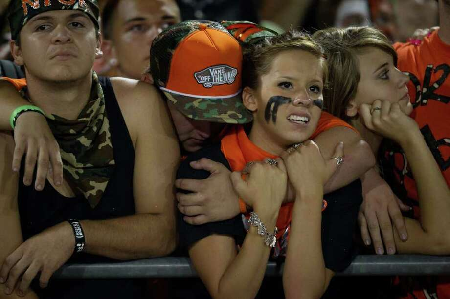 La Porte fans react after a Deer Park touchdown with just over a minute to go forced overtime. Photo: Smiley N. Pool, Houston Chronicle / © 2011  Houston Chronicle