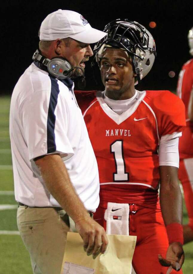QuarterbackJulian Walker #1 talks with head coach Kirk Martin after Manvel turned the ball over on downs against the Manvel Mavericks completes a pass against the La Marque Cougars in the opening of District 24-4A high school football game at Alvin Memorial Stadium in Alvin, Texas. For the Chronicle: Thomas B. Shea Photo: For The Chronicle: Thomas B. She