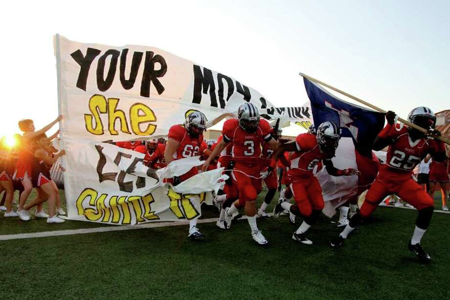 The Manvel Mavericks take the filed before playing against the La Marque Cougars in the opening of District 24-4A high school football game at Alvin Memorial Stadium in Alvin, Texas. For the Chronicle: Thomas B. Shea Photo: For The Chronicle: Thomas B. She