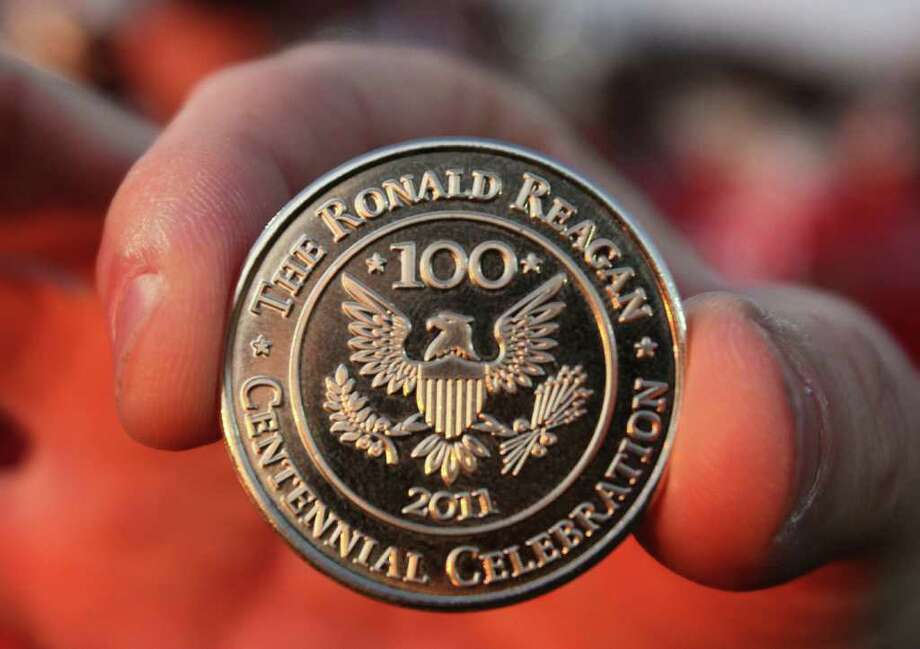 A close-up of the Ronald Reagan Centennial Celebration coin that was used for the flip for the game of the Manvel Mavericks against the La Marque Cougars in the opening of District 24-4A high school football game at Alvin Memorial Stadium in Alvin, Texas. For the Chronicle: Thomas B. Shea Photo: For The Chronicle: Thomas B. She