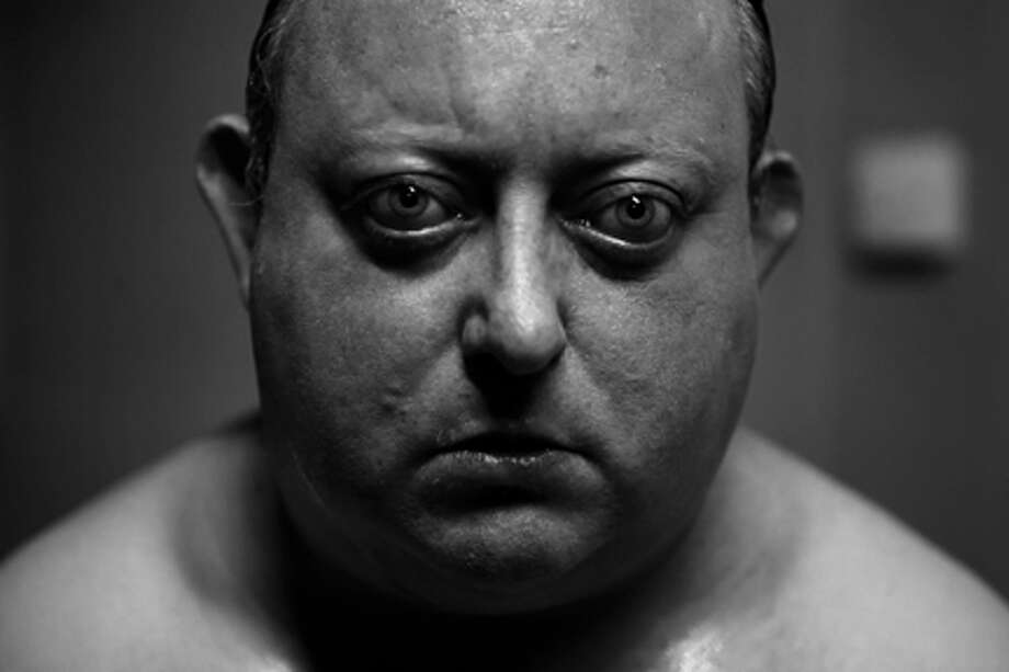 "Laurence R. Harvey as Martin in ""The Human Centipede II (Full Sequence)."""