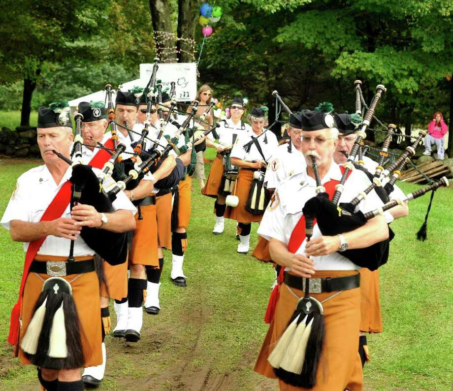 The Celtic Cross Pipes and Drums make their entrance at the Greater Danbury Irish Festival at the Charles Ives Concert Park in Danbury Saturday, Sept 24, 2011. Photo: Michael Duffy / The News-Times