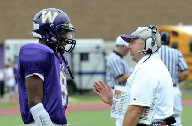 Westhill's head football coach, Dick, Cerone, speaks with RJ Cooper following a Westhill fumble on the field during the football game against Trumbull at Westhill High School in Stamford on Saturday, Sept. 24, 2011. Photo: Amy Mortensen / Connecticut Post Freelance