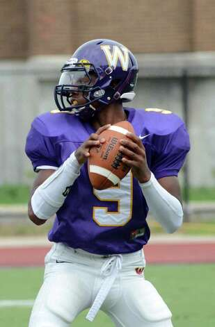 Westhill's RJ Cooper looks to pass during the football game against Trumbull at Westhill High School in Stamford on Saturday, Sept. 24, 2011. Photo: Amy Mortensen / Connecticut Post Freelance