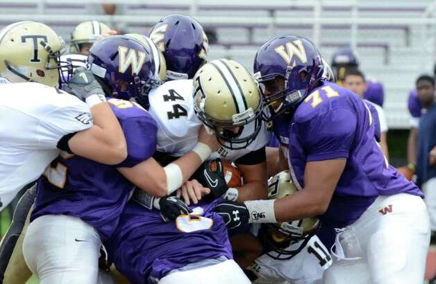 Westhill defenders bring down Trumbull's Don Cherry (44) during the football game at Westhill High School in Stamford on Saturday, Sept. 24, 2011. Photo: Amy Mortensen / Connecticut Post Freelance